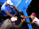 Li Na of China celebrates with her husband Jiang Shan, blue polo,Picture: AP