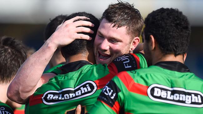 Chris McQueen (c) of the Rabbitohs celebrates.