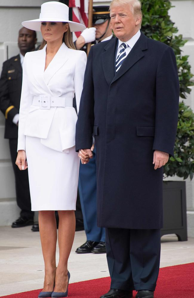 The US President eventually managed to persuade his wife to hold his hand. Picture: AFP/Jim Watson