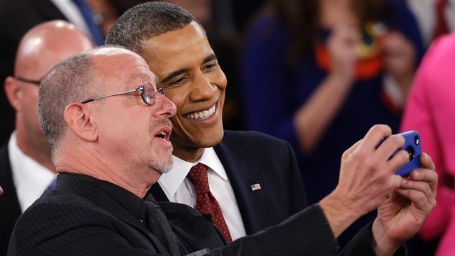 A man takes a photo of himself with President Barack Obama after the second presidential debate at Hofstra University, Tuesday, Oct. 16, 2012, in Hempstead, N.Y. (AP Photo/Eric Gay)