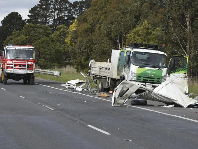 The remains of the van are all but flattened on the road. Picture: Ian Wilson