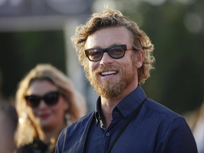 Actor Simon Baker smiles as he arrives at Tropfest in Centennial Park in Sydney. Picture: David Moir