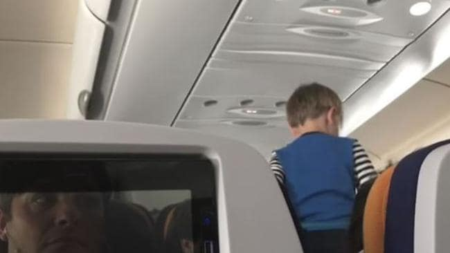 RUSH HOUR: Flight from hell with 'demonic' kid