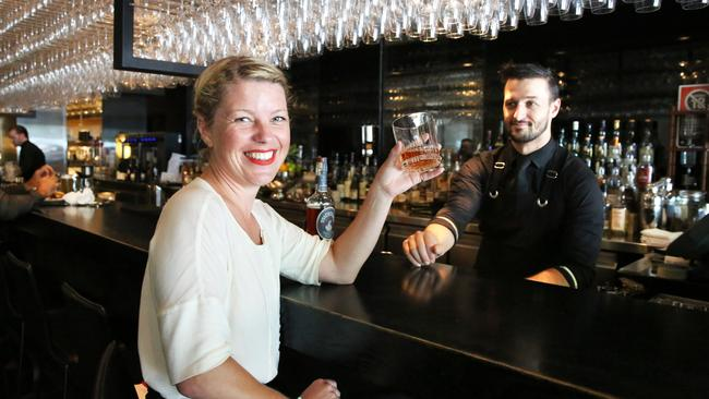 US brand Michter's Celebration Sour Mash Whiskey will be available at Rockpool restaurant bar in the city for $500-nip as bar manager Ryan Gavin serves Libby Travers. Picture: Bob Barker