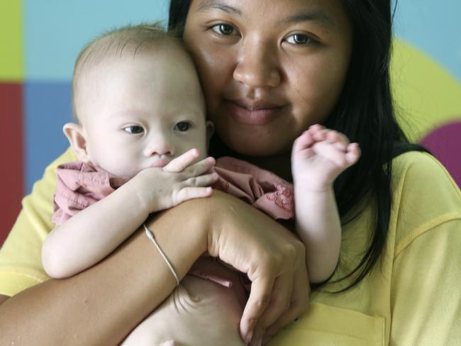 Thai surrogate ... Pattaramon Chanbua, 21, poses with Gammy at a hospital in the Chonburi province, south-eastern Thailand. Picture: AP Photo/Apichart Weerawong