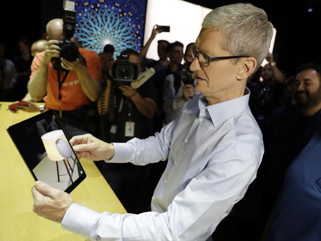 Apple CEO Tim Cook shows an iPad Pro during an announcement of new products at the Apple Worldwide Developers Conference. Picture: Marcio Jose Sanchez
