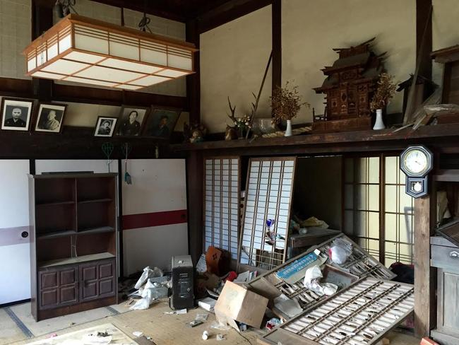 An abandoned, derelict house, one of thousands left vacant across the Fukushima region. Picture: Amos Robert/Dateline