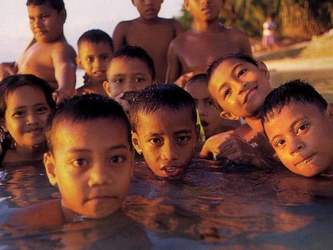 Children swimming in Funafuti Lagoon on the South Pacific island of Tuvalu in 2001. Picture: Peter Bennetts.