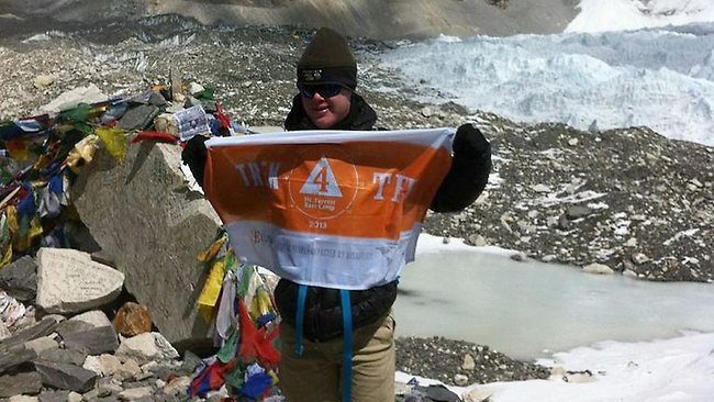 Eli Reimer poses at Everest Base Camp in the shadow of Mount Everest. The 15-year-old has become the first teenager with Down's Syndrome to reach Everest Base Camp. Picture: AFP