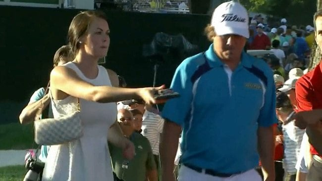 Jason Dufner's wife Amanda hands him his tobacco tin after he won the US PGA title.
