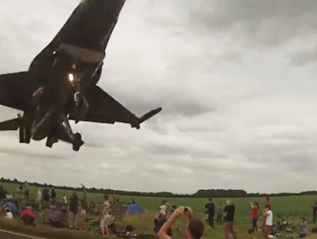 The F16 comes in to land as spectators dive for cover. Picture: Screengrab