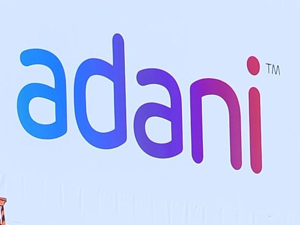 Adani sign being put up on Telstra building in South Townsville. Picture: Zak Simmonds