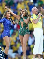 (L-R) Singers Claudia Leitte, Jennifer Lopez and Pitbull perform during the Opening Ceremony of the 2014 FIFA World Cup Brazil prior to the Group A match between Brazil and Croatia at Arena de Sao Paulo on June 12, 2014 in Sao Paulo, Brazil. (Photo by Adam Pretty/Getty Images)