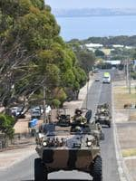 A convoy of Australian light armoured vehicles is seen in Kingscote on Kangaroo Island. Picture: AAP Image/David Mariuz