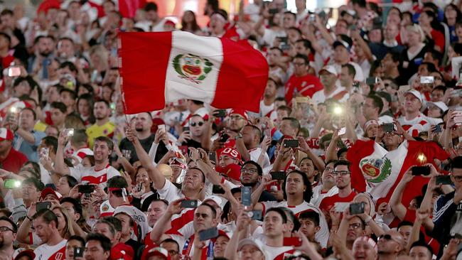 Peru supporters cheer for their team in the first half of the team's international friendly soccer match against Croatia