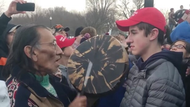 Images showing the confrontation between Covington Catholic High school students and Native American elder and Vietnam veteran, Nathan Phillips during a Indigenous Peoples March through Washington on January 18, 2019.