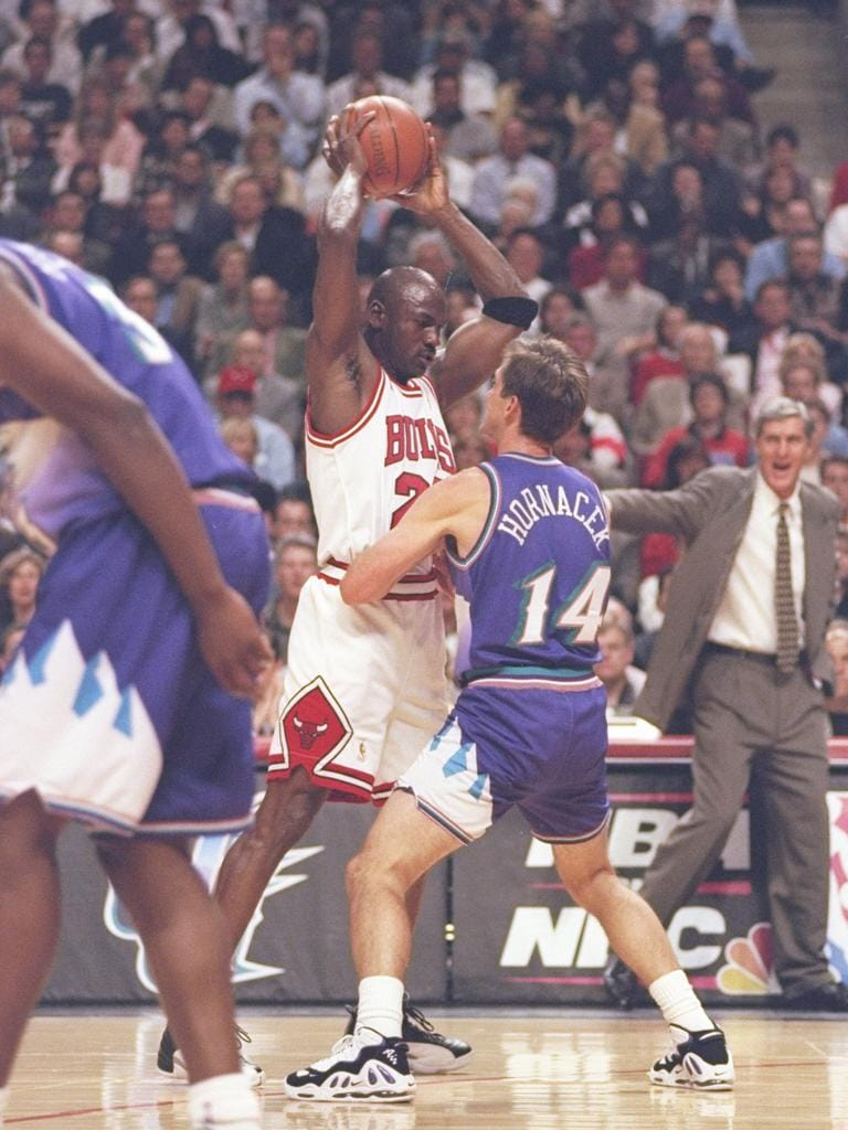 Jerry Sloan watches Jeff Hornacek guard Michael Jordan of the Chicago Bulls duringthe 1997 NBA Finals.