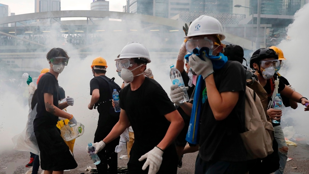 Panic spreads through Hong Kong protest as officers fire tear gas