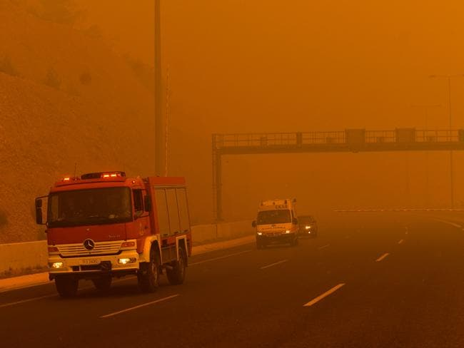 The haze of orange smoke blanketing cities. Picture: AFP