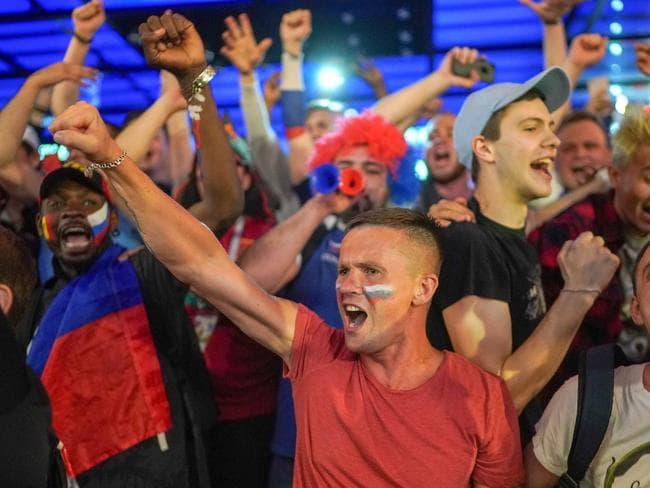 Russian fans celebrate their team's 3-1 win over Egypt. They're on board, bus is the official news agency? Pic: Getty