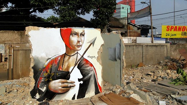 Woman with weasel and spear, Jakarta 2012. Picture: Fintan Magee / Facebook
