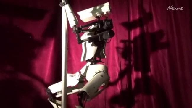 Robot strippers make appearance at gentleman's club during electronics convention