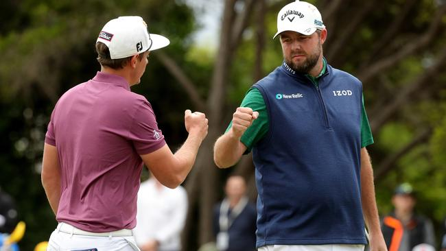 Cameron Smith and Marc Leishman celebrate a birdie on the second hole.