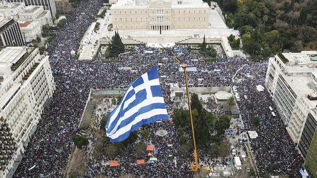 Demonstrators wave Greek national flags during a demonstration February 4 to protest a potential Greek compromise in a dispute with neighbouring Macedonia over the former Yugoslav republic's official name. Picture: Lefteris Partsalis/InTime News via AP