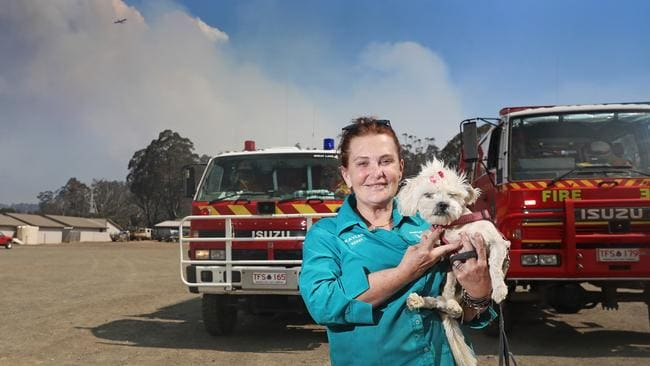 Kaylee Hattinger, owner of the Great Lakes Hotel, with her dog, Betty. Kaylee is adamant she will stay and defend the hotel if the fire comes to the township of Miena. Picture: LUKE BOWDEN