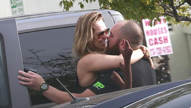 Ronda Rousey spotted kissing boyfriend Travis Browne shortly after leaving their gym in Los Angeles. Picture: Sharky/Splash News.