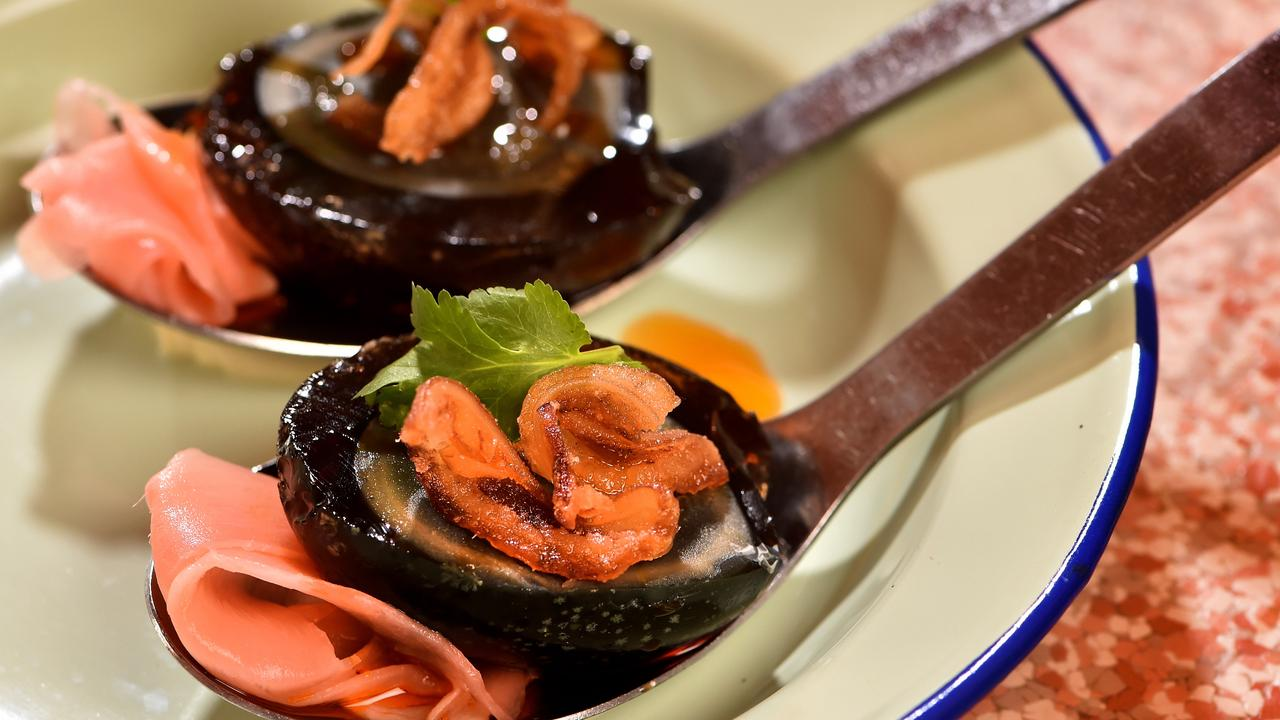 This dish is a modern way to present century eggs, served here with crispy pig's ear and chilli oil. Picture: Jay Town