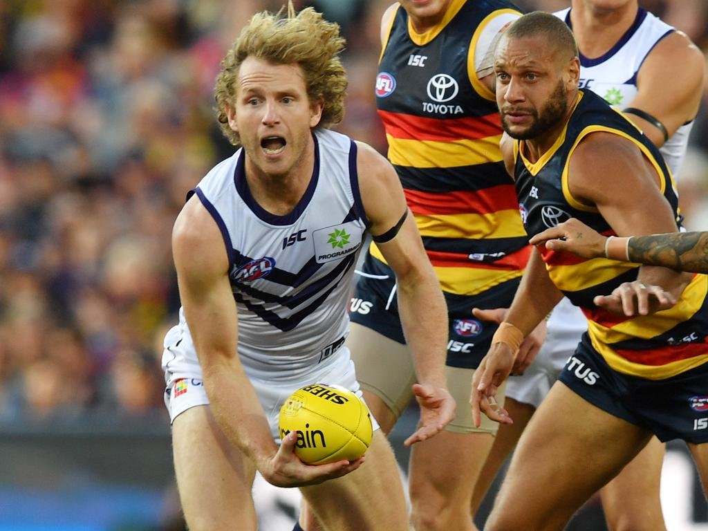 David Mundy of the Dockers and Cameron Ellis-Yolmen of the Crows during the Round 7 AFL match between the Adelaide Crows and the Fremantle Dockers at the Adelaide Oval in Adelaide, Sunday, May 5, 2019. (AAP Image/David Mariuz) NO ARCHIVING, EDITORIAL USE ONLY
