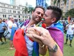 Brad harker and Scott D'Amico celebrate the decision. Same-sex couples and their friends and family gather in Brisbane. Picture: Peter Wallis