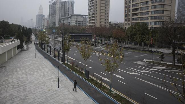 A man walks alone on an empty road on January 27 in Wuhan, China. Picture: Getty Images