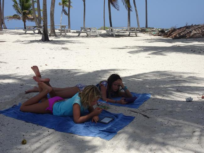 The kids kick back during a relaxing day at Lighthouse Reef. Picture: Gary Burchett