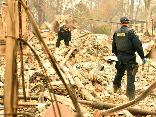 Alameda County Sheriff Coroner officers search for human remains after the Camp fire tore through the region in Paradise. Picture: Josh Edelson / AFP
