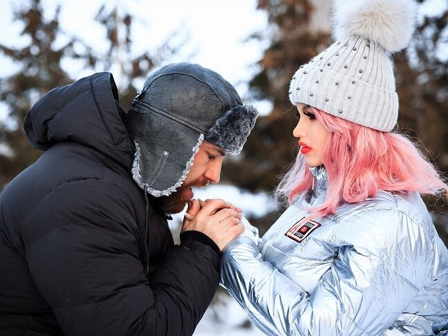 Yuri warms Margo's hands in the snow.