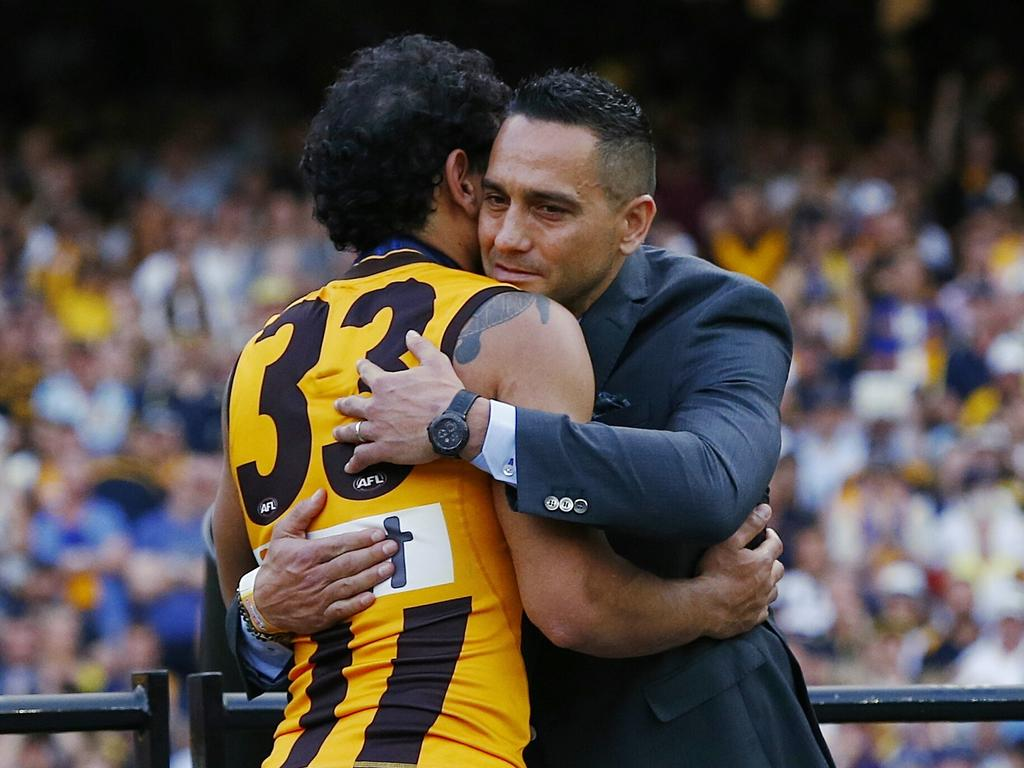 Cyril Rioli got a hug from Andrew McLeod as he accepted the 2015 Norm Smith Medal. Picture: Colleen Petch