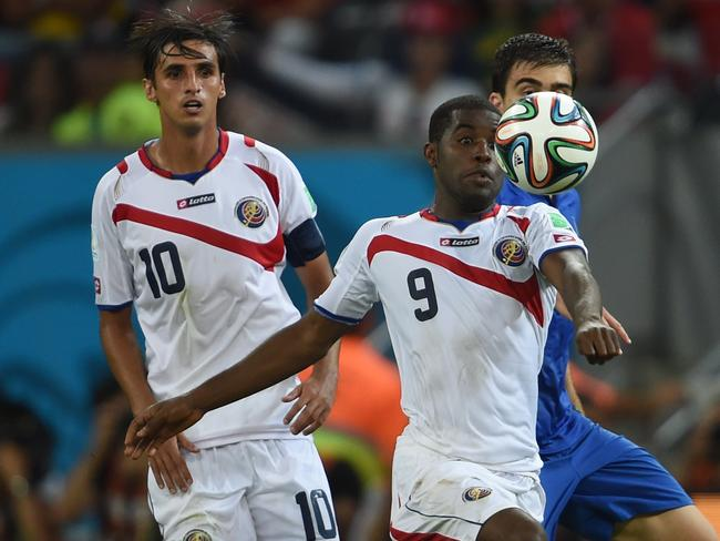 Costa Rica's forward Joel Campbell keeps his eyes on the ball. His team is just holding on.