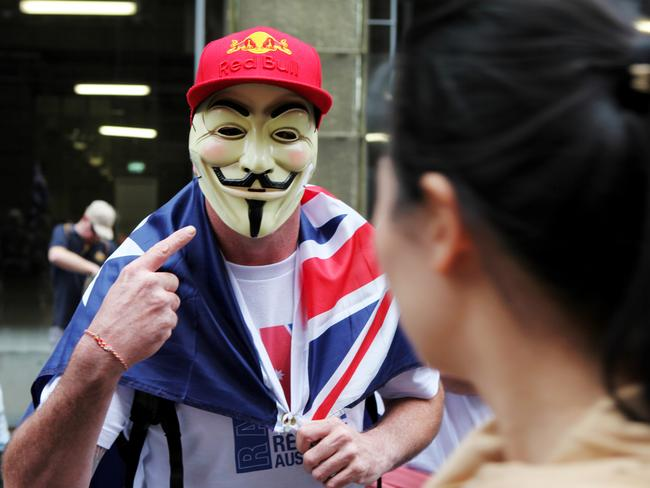 "A man wearing a mask representing the hacking group ""Anonymous"" attends the Reclaim Australia Rally at Martin Place in Sydney on Sunday."