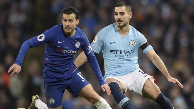 Pedro duels for the ball with Ilkay Gundogan.