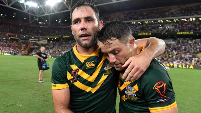 Cameron Smith of Australia and teammate Cooper Cronk celebrate winning the Rugby League World Cup.