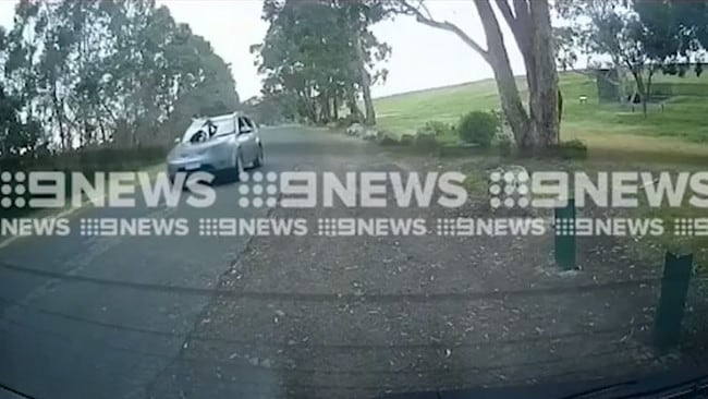 Dashcam vision of a child on a car's bonnet in Melbourne. Picture: 9 News