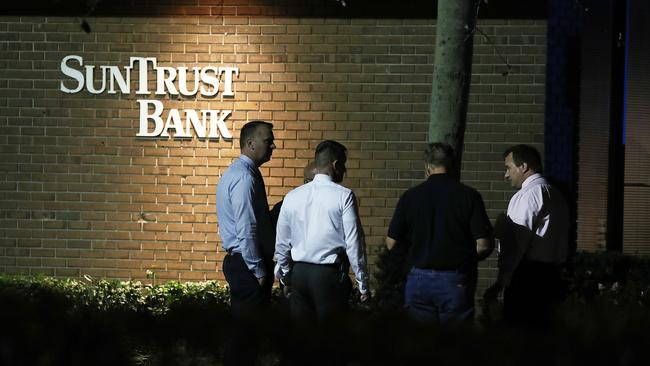 Law enforcement officials investigate the scene where at least five people were killed at a SunTrust Bank branch. Picture: Joe Raedle/Getty/AFP