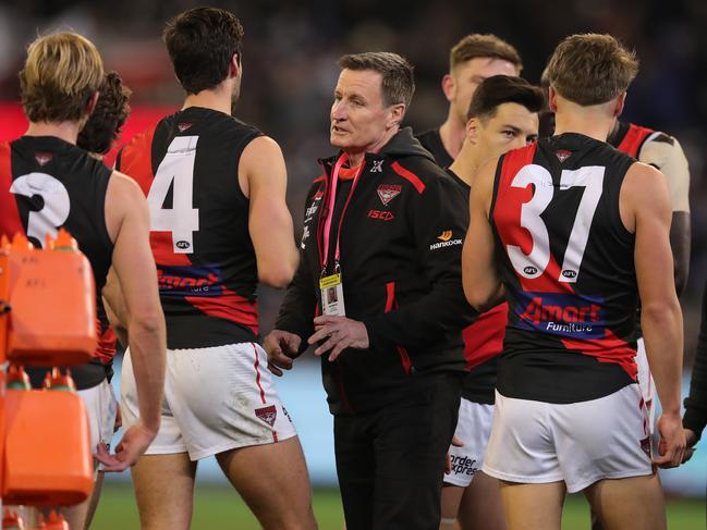 Essendon's coach John Worsfold talks with Kyle Langford at three-quarter time of the game against Collingwood last weekend. Picture: Michael Klein