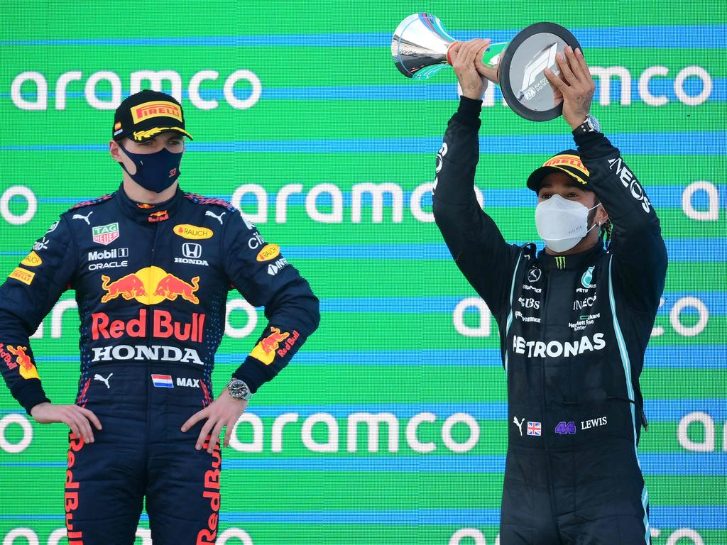 TOPSHOT - Mercedes' British driver Lewis Hamilton (R) celebrates on the podium next to Red Bull's Dutch driver Max Verstappen after the Spanish Formula One Grand Prix race at the Circuit de Catalunya on May 9, 2021 in Montmelo on the outskirts of Barcelona. (Photo by LLUIS GENE / AFP)