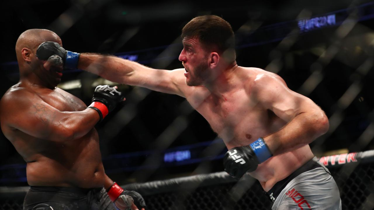 Stipe Miocic (R) and Daniel Cormier will make history in their third heavyweight clash on Sunday.