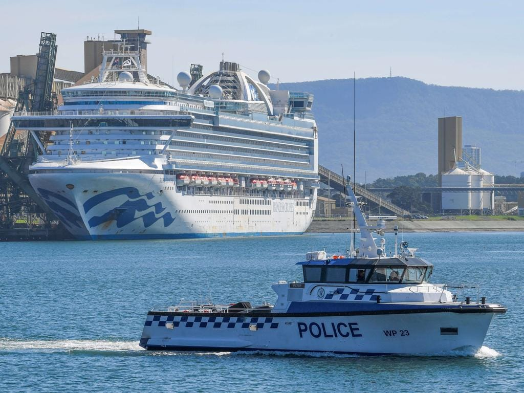 Water police patrol the contaminated cruise ship Ruby Princess while it berths in Port Kembla in April. Picture: Simon Bullard