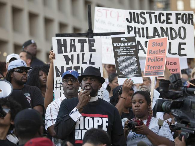 People rally to protest the deaths of Alton Sterling and Philando Castile. Picture: AFP/Laura Buckman