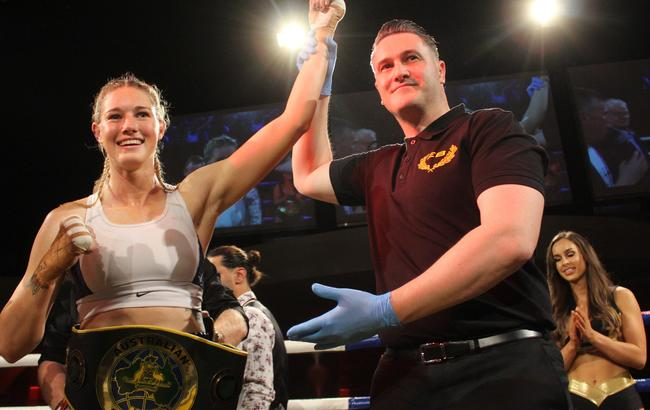 Tayla Harris with her Middleweight Title belt. Picture: Tamara Jane Photography